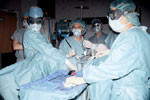 Doctors operating on an endometriosis patient